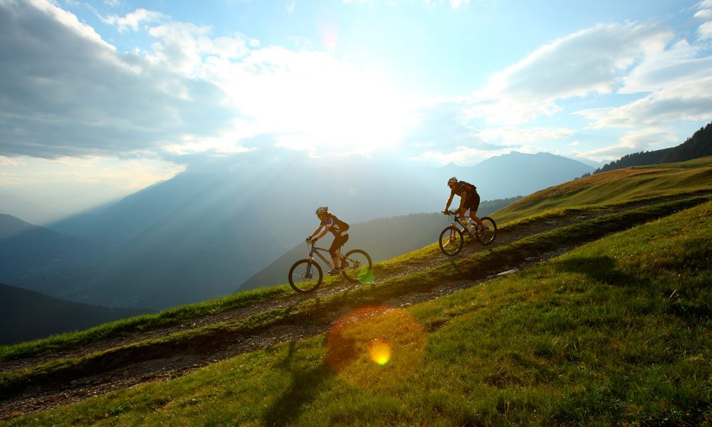 Climbing and walking – motor bike and mountain bike